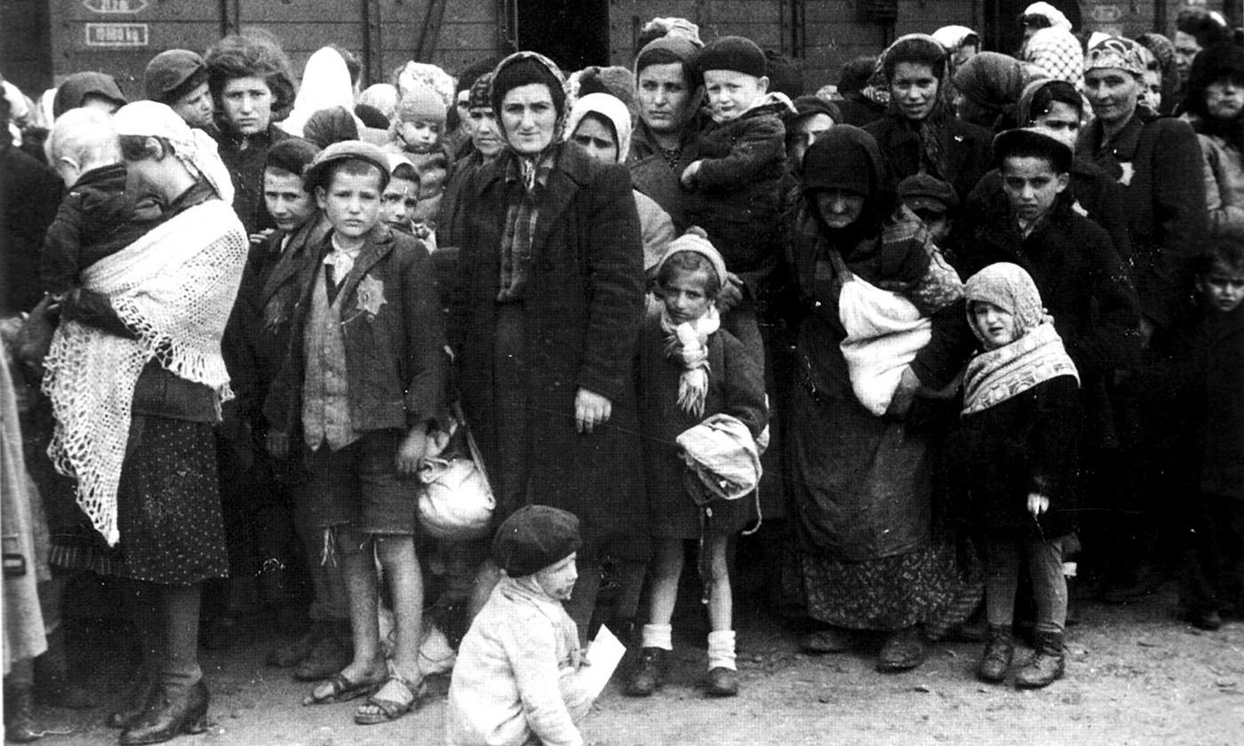 Hungarian Jewish women and children on arrival at the Auschwitz camp in 1944. <em>Photo courtesy German Federal Archives/Wikipedia</em>