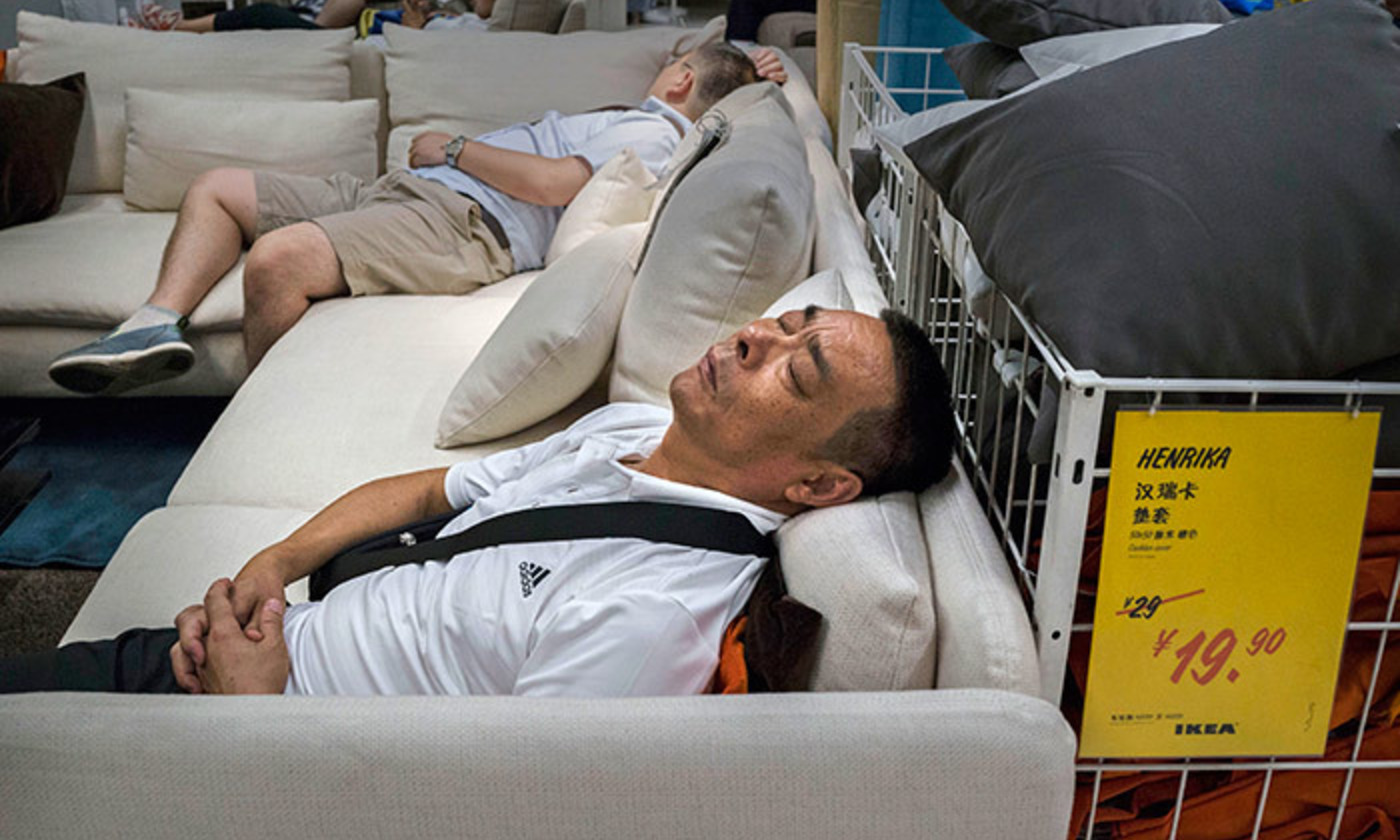 All too much; Ikea shoppers overwhelmed in the showroom, 6 July 2014, Beijing, China. <em>Photo by Kevin Frayer/Getty</em>