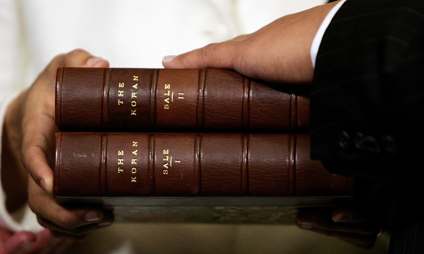 <p>Thomas Jefferson's copy of George Sale's 1734 translation of the Quran is used in the swearing in ceremony of US Representative Keith Ellison at the United States Capitol in Washington, DC, on 4 January 2007.<em> Photo by Getty</em></p>