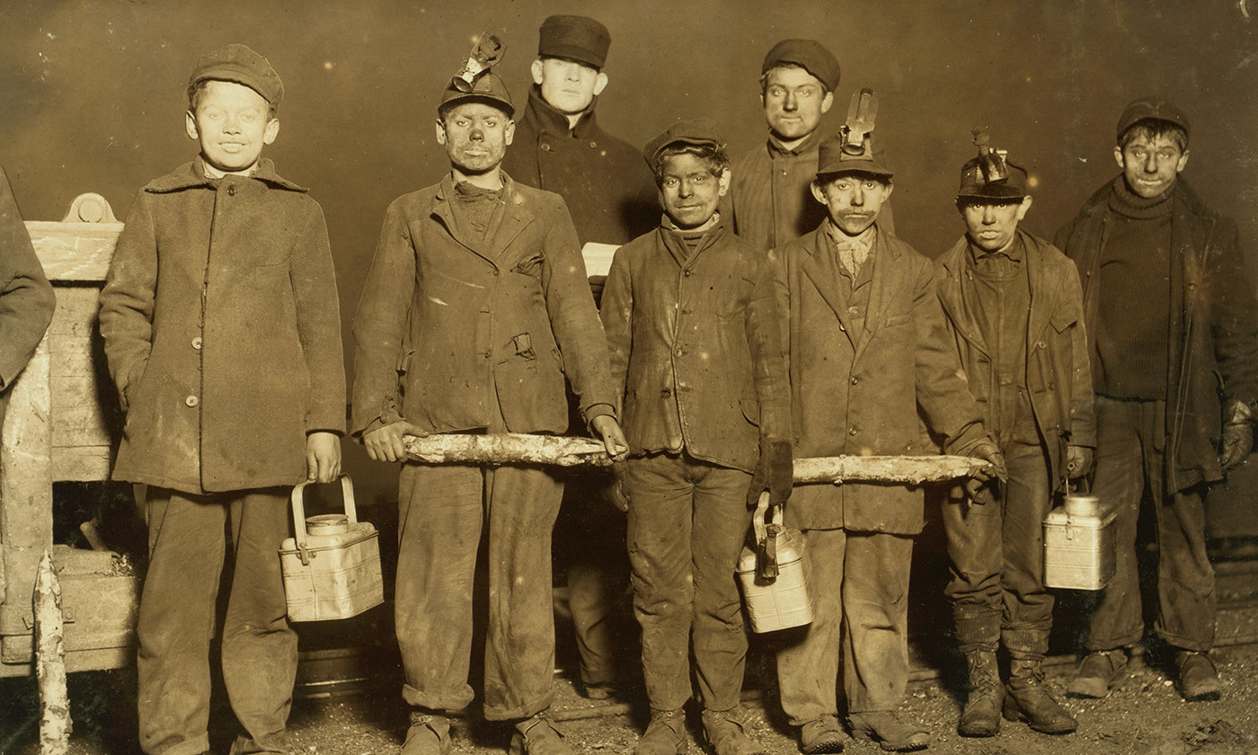 <p>Child mine workers in South Pittston Pennsylvania <em>c</em>1908-11. They worked a mile underground for as little as 75c a day. <em>Photograph by Lewis Hine/Library of Congress</em></p>