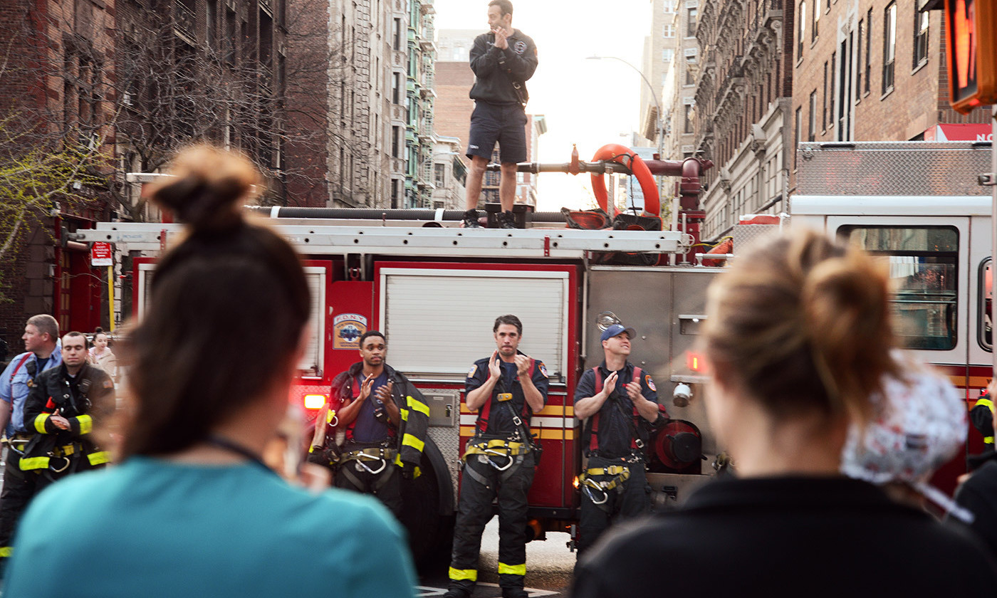 <p>Firefighters applaud medical workers in Manhattan, New York, on 7 April 2020. <em>Photo B A Van Sise/NurPhoto via Getty</em></p>