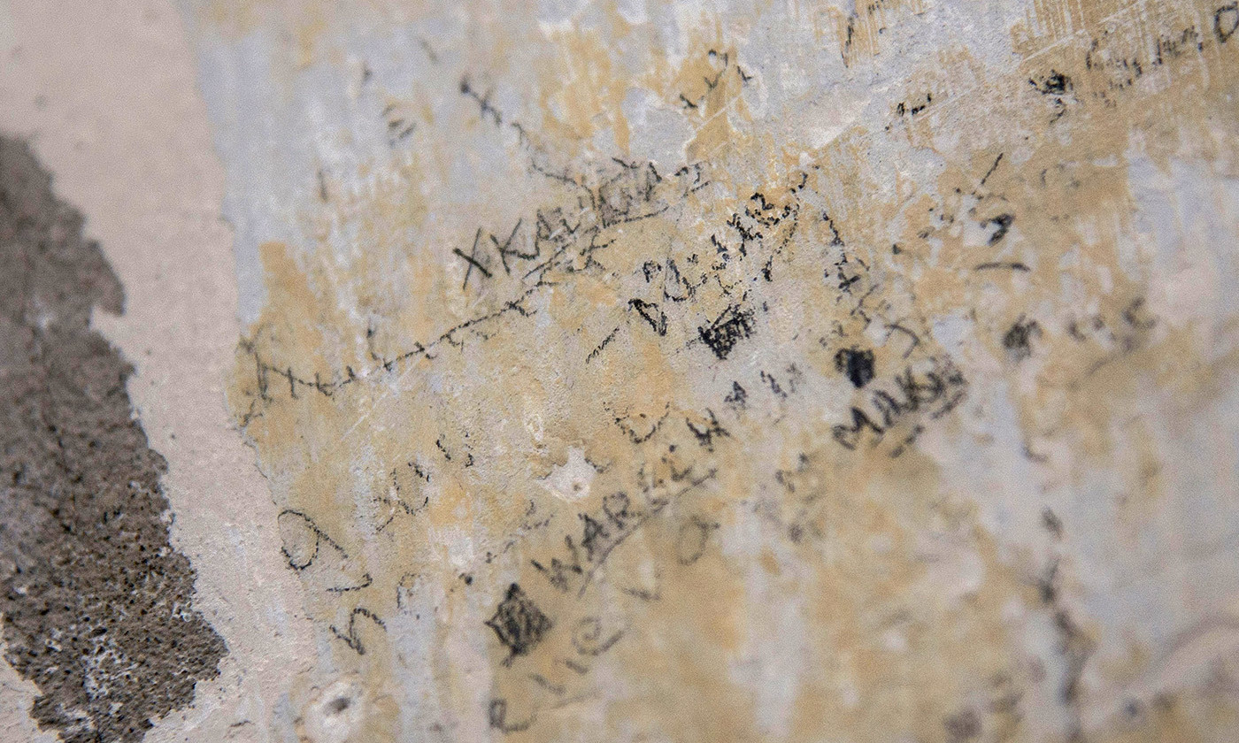 <p>Recently discovered prisoner writings on the wall of Lyon's notorious Montluc prison from which <em>résistant</em> and historian Marc Bloch was taken and executed by the Nazis on the night of the 16 June 1944. A noted historian, Bloch wrote: 'The task of the historian is understanding, not judging.' <em>Photo by Bony/AP/Rex.</em></p>