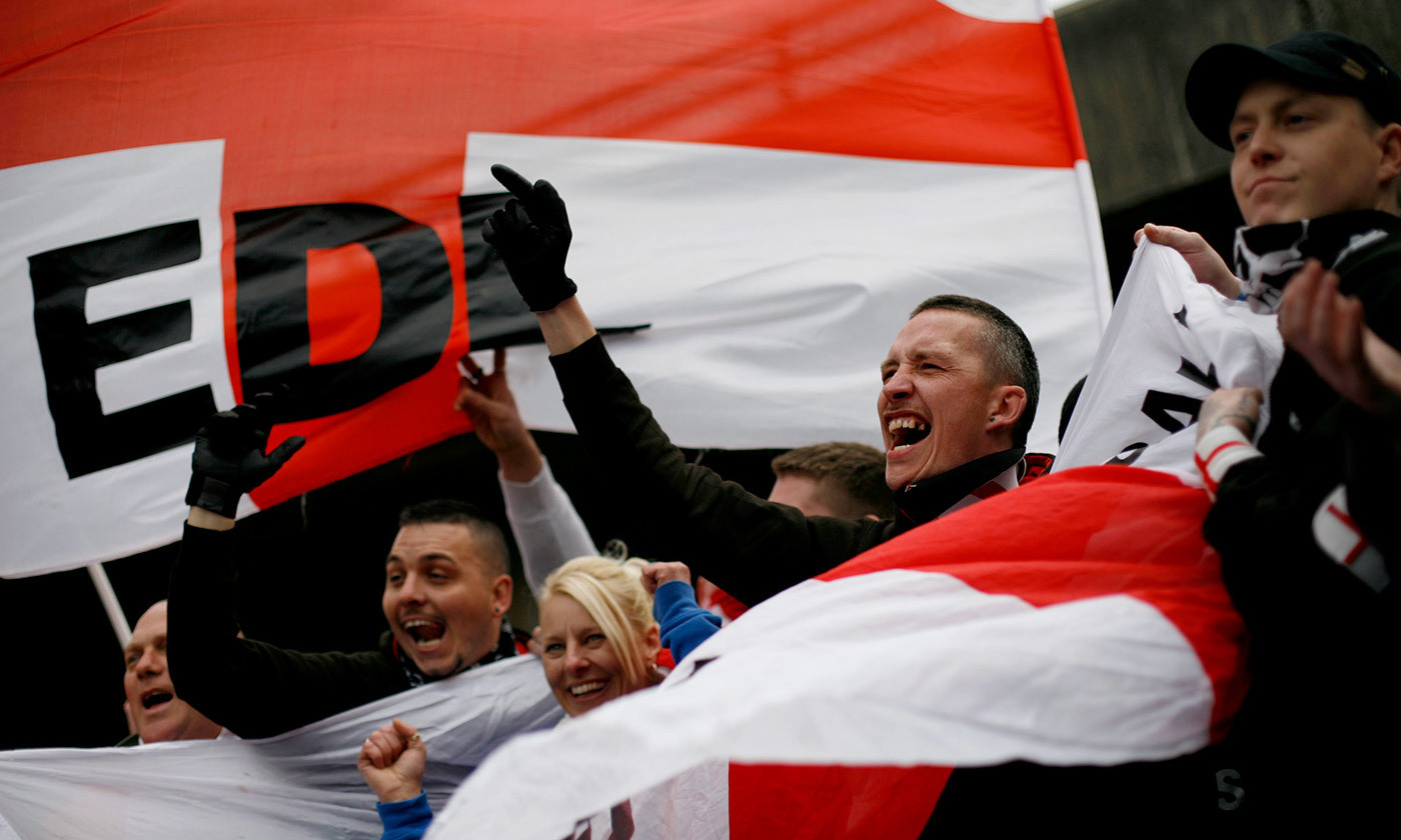Members of the far-Right English Defence League protest in Luton, UK, in 2012. <em>Photo by Tal Cohen/AFP/Getty</em>