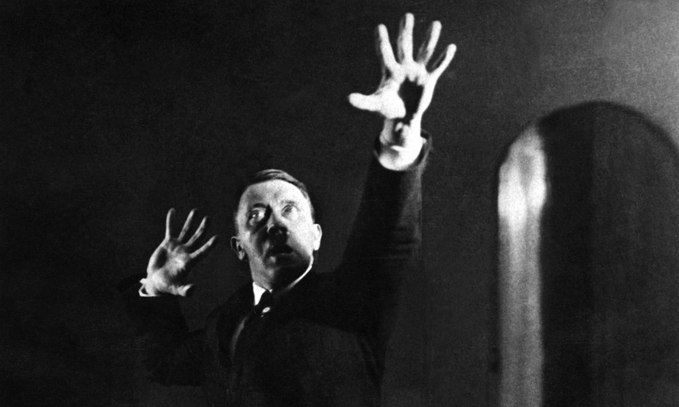 Look into my eyes... Adolf Hitler photographed by his personal photographer practicing for public speaking in 1925. <em>Photo by Gamma/Getty</em>