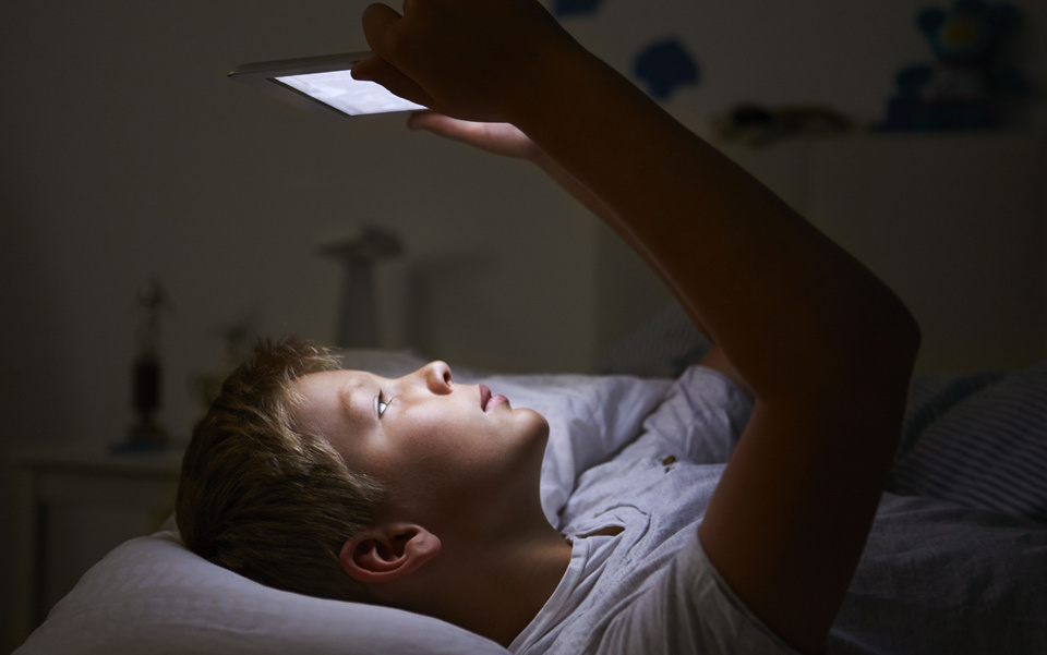 The National Sleep Foundation says that more than 90 per cent of Americans regularly use some type of electronic device in the hour before bed. Photo by Rex Features