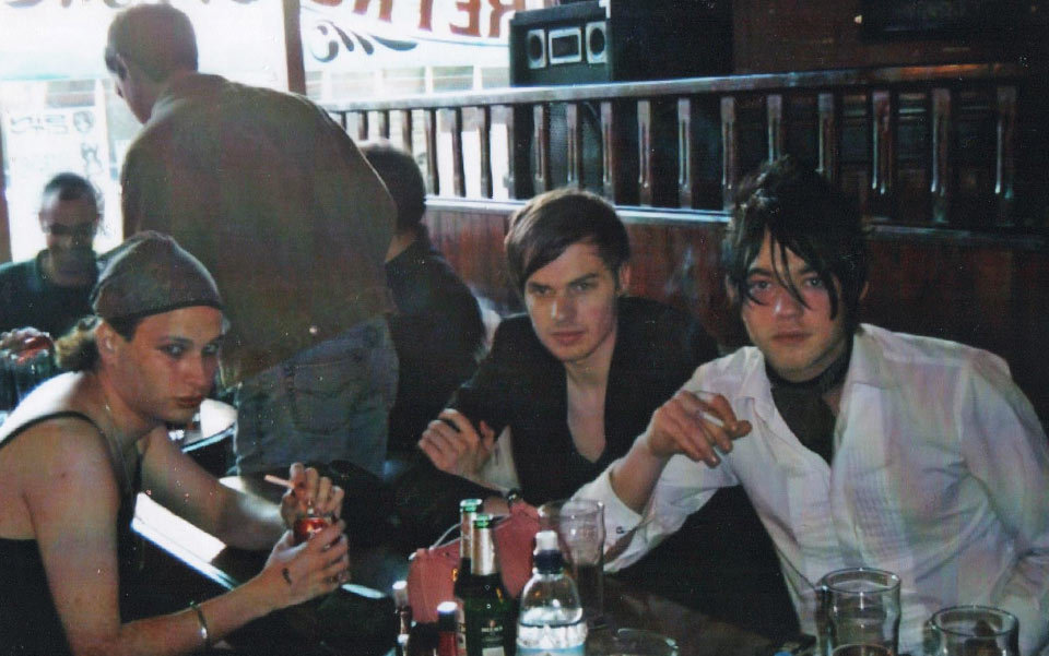 Cautiously optimistic about the future: aged 22 (left) with Joe Stretch (centre) and Joe Cross (right) at the Retro Bar, Manchester, summer 2004. Photo courtesy of the author