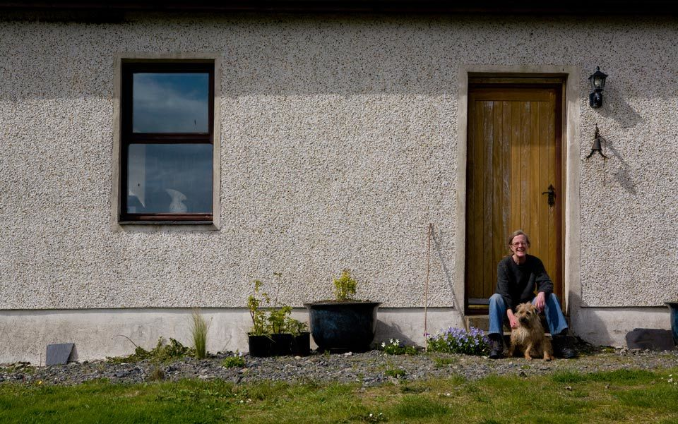 Author Sara Maitland outside her Highland home.